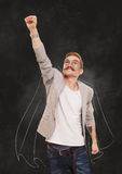 Man Superhero in flying pose at black background Stock Images