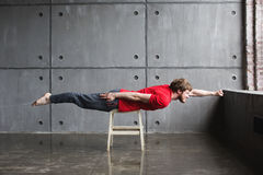Man in superhero pose Stock Image