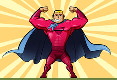 Super hero. A man superhero with a red suit and a blue cape Royalty Free Stock Images