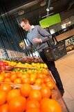 Man in Supermarket Buying Fruit Stock Image