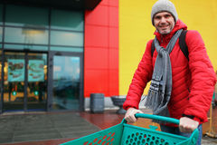 Man with supermarket cart Stock Photography