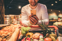 Man at the supermarket Stock Images
