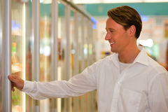 Man in supermarket freezer section Royalty Free Stock Images
