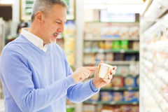 Man in a supermarket. Man shopping in a supermarket Royalty Free Stock Photography