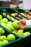 Man in supermarket shopping groceries Stock Image