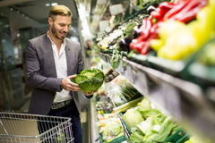 Man in supermarket Royalty Free Stock Photo