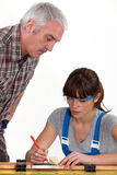 Man supervising his assistant Stock Images