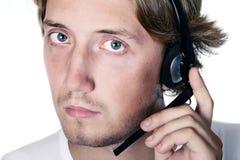 Man support. Serious man speak headphone. Isolated white Royalty Free Stock Photos