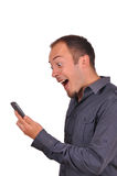 Man suprised by phone call Stock Image