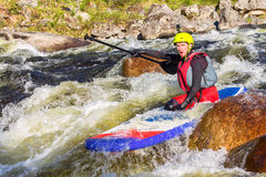 The man supsurfing on the rapids of the mountain river. The man fell from SUP surfing on the rapids of the mountain river stock photo