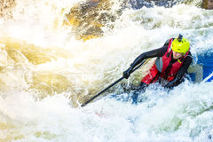The man supsurfing on the rapids of the mountain river. The man fell from SUP surfing on the rapids of the mountain river stock photos