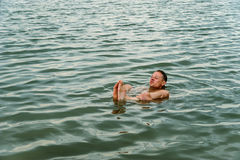 Man on the surface of the water. Royalty Free Stock Photos