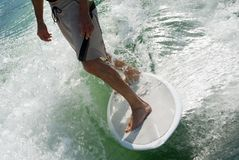 Man on Surfboard Stock Photos