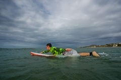 Man on a surfboard Royalty Free Stock Images