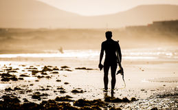 Man with a surfboard Royalty Free Stock Photography