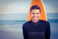 Man with surfboard in swimsuits Royalty Free Stock Photo