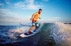 Man surfboarding Stock Images