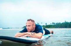Man surfer rests lying on surfboard Royalty Free Stock Photos