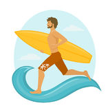 Man surfer running with surfboard to catch the wave. Stock Photo