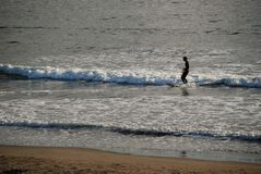A surfing man. A man surfer surfing on surfboard on the sea wave in Sagami Bayn Stock Images