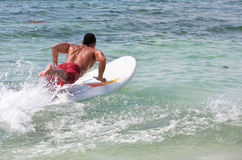 Man surfing Stock Images