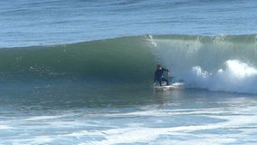 Man Surfing on a Big Wave in California in Slow Motion