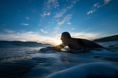 Man Surfing during Blue Hour royalty free stock image