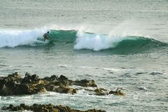 Man surfing on the breaking waves in Pacific Ocean at Hanga Roa, Easter Island, Chile, South America stock photo