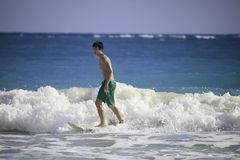 Man surfing in hawaii. Young asian american man surfing in hawaii Stock Images