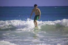Man surfing in hawaii Stock Photo