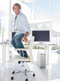 Man surfing his swivel chair Royalty Free Stock Image