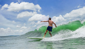 Man Surfing. Picture of Man Surfing a Wave stock photo