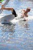 A man surfing in a pool at LKXA Extreme Sports Barcelona Games. BARCELONA - JUN 29: A man surfing in a pool at LKXA Extreme Sports Barcelona Games on June 29 stock images