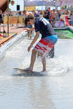 A man surfing in a pool at LKXA Extreme Sports Barcelona Games Stock Photo