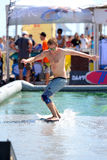 A man surfing in a pool at LKXA Extreme Sports Barcelona Games. BARCELONA - JUN 29: A man surfing in a pool at LKXA Extreme Sports Barcelona Games on June 29 royalty free stock image