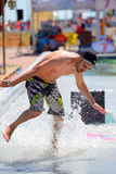 A man surfing in a pool at LKXA Extreme Sports Barcelona Games. BARCELONA - JUN 29: A man surfing in a pool at LKXA Extreme Sports Barcelona Games on June 29 stock photos