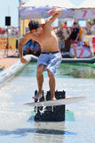 A man surfing in a pool at LKXA Extreme Sports Barcelona Games royalty free stock photography