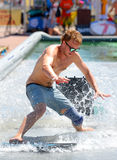 A man surfing in a pool at LKXA Extreme Sports Barcelona Games stock image