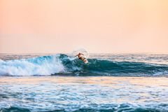 Man Surfing on Sea Waves Using White Surfboard during Daytime Royalty Free Stock Images
