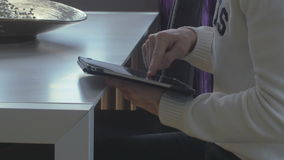 Man surfing on a tablet stock footage