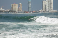 Man surfing on a wave in Iquique Chile. Royalty Free Stock Images