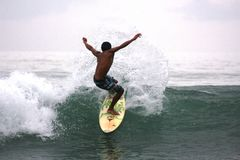 Man surfing the waves Stock Image
