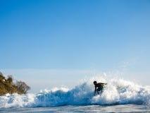 Man surfs crashing wave Stock Photos