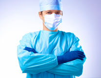 Man surgeon holds a scalpel in an operating room Stock Photo