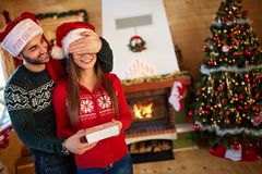 Man surprise girl with gift. Man surprise girl with Christmas gift Stock Images
