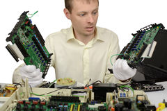Man with surprise looks at parts Computers stock images