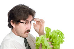 Man with surprise looks at sheet of the salad Royalty Free Stock Image