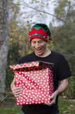 Man surprised by Christmas gifts! Royalty Free Stock Images