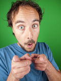 Man with surprised expression pointing at you Stock Photography