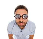Man with a surprised expression and thick glasses Royalty Free Stock Images